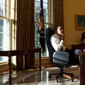 President Barack Obama sits in the Oval Office on his first day in office, Jan. 21, 2009. (Official White House Photo by Pete Souza)
