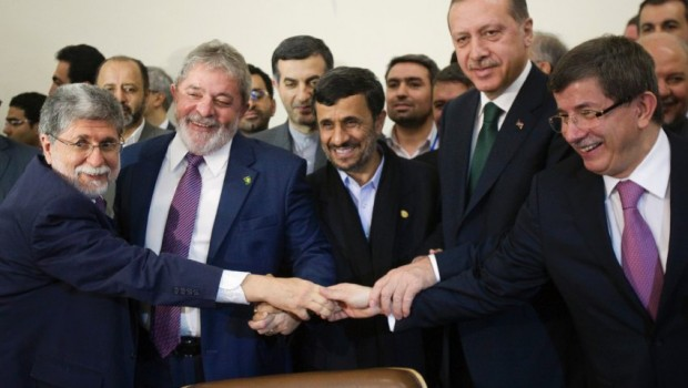 Brazilian FM Amorim Iranian President Ahmadinejad, Brazilian President da Silva, Turkish PM Erdogan and Turkey's FM Davutoglu hold their hands as sign of unity during signing agreement ceremony in Tehran